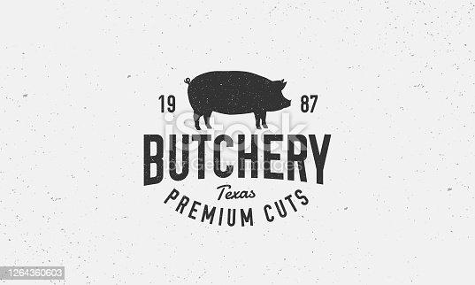 istock Butchery vintage logo. Meat shop emblem in retro style. Pork label, emblem, badge with pig silhouette. Vector illustration 1264360603