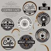 Various shaped cafe labels with coffee stains