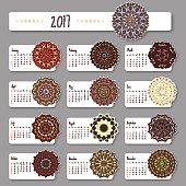 Calendar 2017 start sunday with hand drawn mandala. Vintage oriental style. Vector illustration.