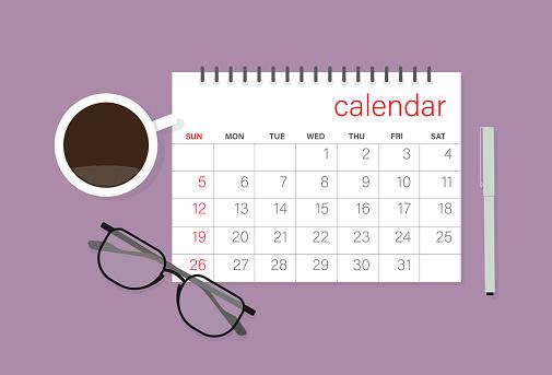 Calendar, eyeglasses, coffee cup and pen