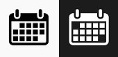 Calendar Icon on Black and White Vector Backgrounds. This vector illustration includes two variations of the icon one in black on a light background on the left and another version in white on a dark background positioned on the right. The vector icon is simple yet elegant and can be used in a variety of ways including website or mobile application icon. This royalty free image is 100% vector based and all design elements can be scaled to any size.