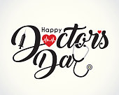 istock Calligraphic of happy doctor's day with symbol of heartbeat, syringe & stethoscope 1145656901