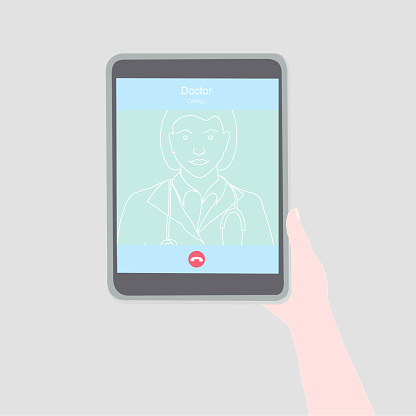 Calling to the doctor by a video call with a tablet