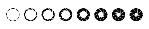 Camera lens aperture with various iris position Camera lens aperture with various iris position. aperture stock illustrations