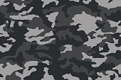 istock Camouflage pattern. Dark black seamless texture. Vector camo print background. Abstract military style backdrop 1205055043