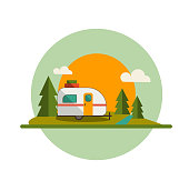 istock Camper Trailer Forest and Sun 1205392088
