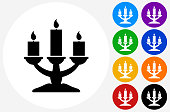 Candle Holder Icon on Flat Color Circle Buttons. This 100% royalty free vector illustration features the main icon pictured in black inside a white circle. The alternative color options in blue, green, yellow, red, purple, indigo, orange and black are on the right of the icon and are arranged in two vertical columns.