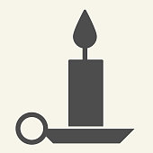Candle solid icon. Holiday candlestick on holder glyph style pictogram on white background. New Year or Christmas candle for mobile concept and web design. Vector graphics