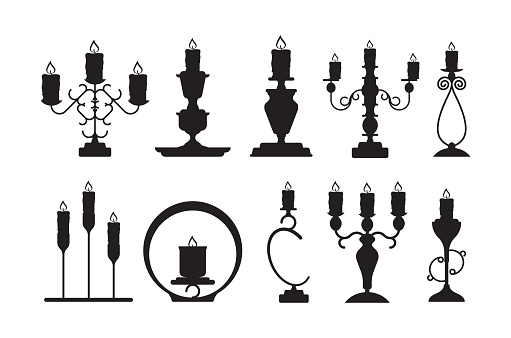 Candlestick silhouettes. Black shapes of candelabrum with burning flame vector candle holders set