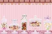 Candy jars with chocolates, candies and dragees