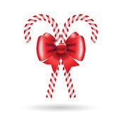 Candy canes with red bow. Vector illustration for Christmas posters, icons, Christmas greeting cards, Christmas print and web projects.
