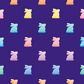 Vector seamless pattern of colorful candy easter bunnies on a purple background.