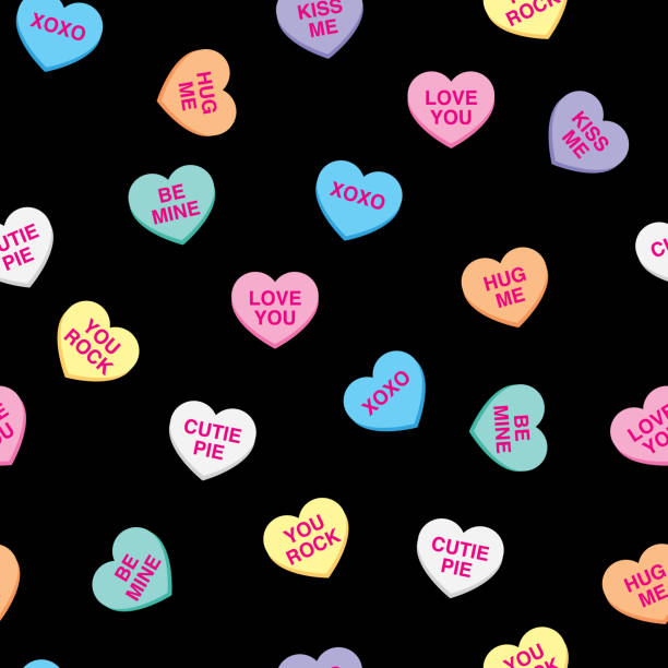 Candy Hearts Pattern Vector illustration of candy hearts in a repeating pattern against a black background. candy patterns stock illustrations