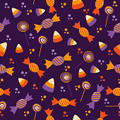 istock Candy Seamless pattern for Halloween - Candy corn, lollipop, and sweets on purple background. 1278596785