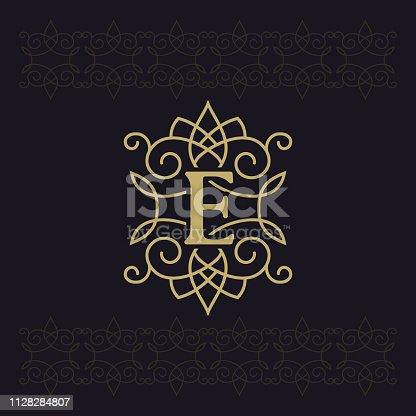 istock Capital letter E. Beautiful monogram. Elegant logo. Calligraphic design. Luxury emblem. Vintage ornament. Simple graphics style. Flourishes boutique brand on black background. Vector illustration 1128284807