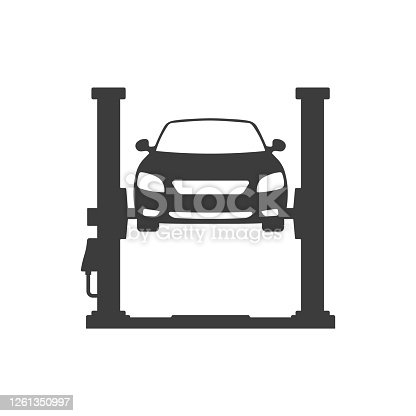 istock Car repair. Car lifted on auto lift. 1261350997