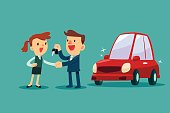 car salesman give a handshake and new car key to businesswoman