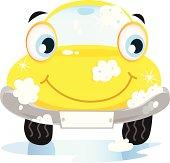 Car wash service - happy yellow automobile with soap bubbles