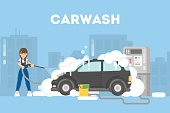 Car washing service. Funny girl in uniform washes car with soap and water.