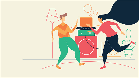 Carefree couple dancing in living room at home