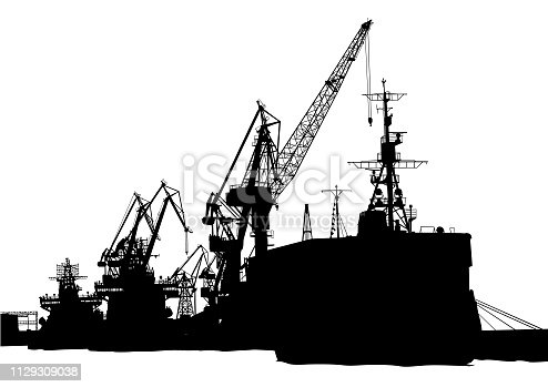 Silhouettes of cargo cranes in the seaport
