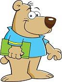 Cartoon bear holding a book.