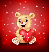 Illustration of Cartoon bear holding red heart balloons