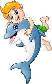Cartoon boy playing with dolphin
