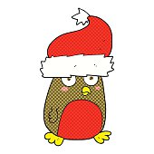 freehand drawn cartoon christmas robin wearing christmas hat
