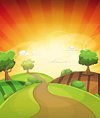 Vector illustration of a cartoon summer or spring rural landscape, with trees, meadows and harvest fields, over a yellow and orange sky with sunbeams. Vector eps and high resolution jpeg files included.