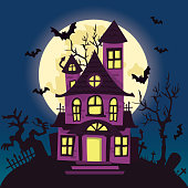 A vector illustration of a cartoon creepy haunted house on halloween night.