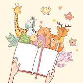 Cartoon cute animals, hands holding fairy tale book with space for your text