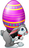 Vector illustration of Cartoon easter bunny carrying easter eggs