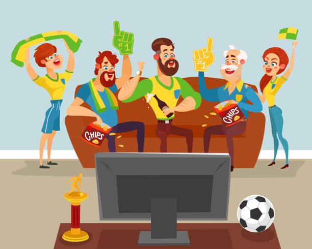 Cartoon family watching a football match on TV Vector cartoon illustration of a family of football fans watching a football match on TV family watching tv stock illustrations