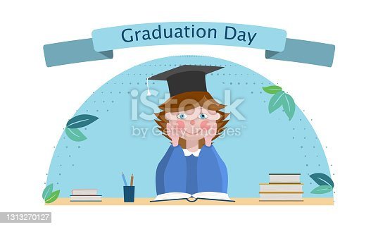 istock Cartoon girl sitting at the table. On the table is an open book and piles of books, a glass with pencils. On the girl's head is an academic cap. Caption: Graduation Day. 1313270127