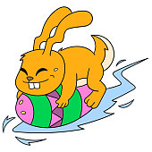 the rabbit riding the easter egg glided happily. vector illustration art, doodle icon image kawaii.