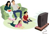 Family sits in living room watching television. 2 parents, 2 kids, mom holds a bowl of popcorn.