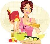 A pretty young woman experiments in the kitchen, following a recipe book to make an exotic salad.