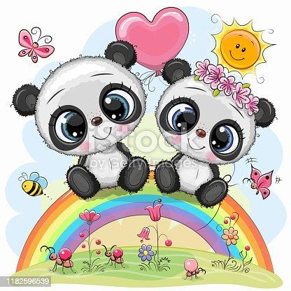 istock Cartoon Pandas are sitting on the rainbow 1182596539