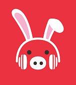 Cartoon Pig wearing a  Rabbit's headset, , enjoy the music,vector