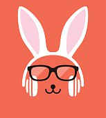 Cartoon Rabbit wearing a headsett and glasses, enjoy the music,vector