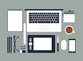 Cartoon rendering of an organized desktop with office tools