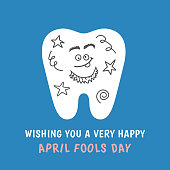 Cartoon tooth painted with doodles joke prank. Happy April Fools Day! Dental illustration isolated on blue background. Greeting card from dentistry.
