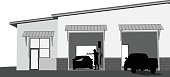A vector silhouette illustration of a car wash with a man cleaning his car and a truck pulling into the station.