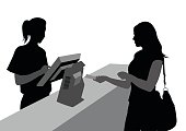 A vector silhouette illustration of a woman paying at a checkout counter handing cash to a yougn female cashier operating the cash regisister.