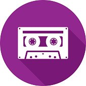 Vector illustration of a purple cassette icon in flat style.