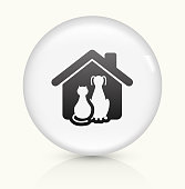 Cat and Dog Icon on simple white round button. This 100% royalty free vector button is circular in shape and the icon is the primary subject of the composition. There is a slight reflection visible at the bottom.