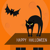 Cat arch back. Kitty on roof. Yellow eyes, fangs, curl whisker. Flying bat. Happy Halloween card. Moon, house, windows. Funny cartoon character Isolated Orange background. Flat design