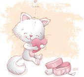 Cute kitten hugging a super soft heart shaped pillow on Valentine's day.