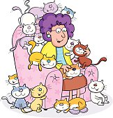 Elderly lady with all her cats.